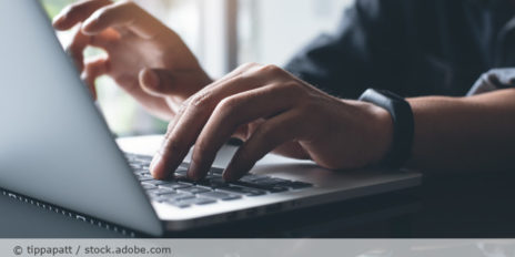 Laptop_working_on_laptop_computer_AdobeStock_236629968